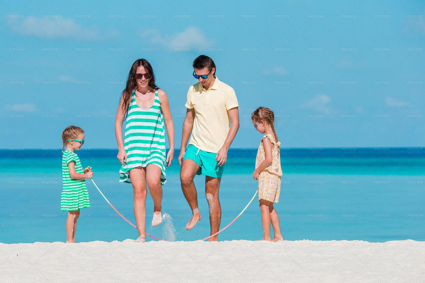 Jumping Rope On The Beach: Stock Photos