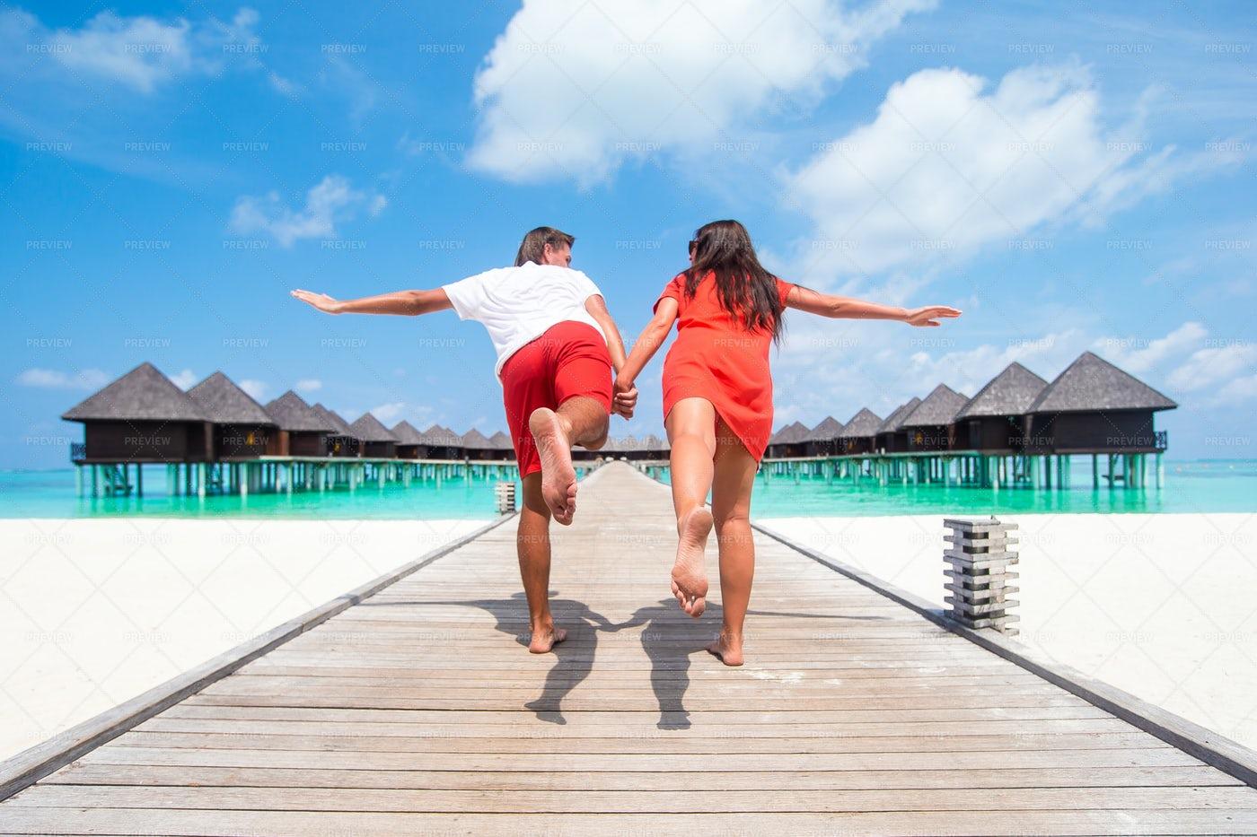 Couple Fooling Around On The Beach: Stock Photos