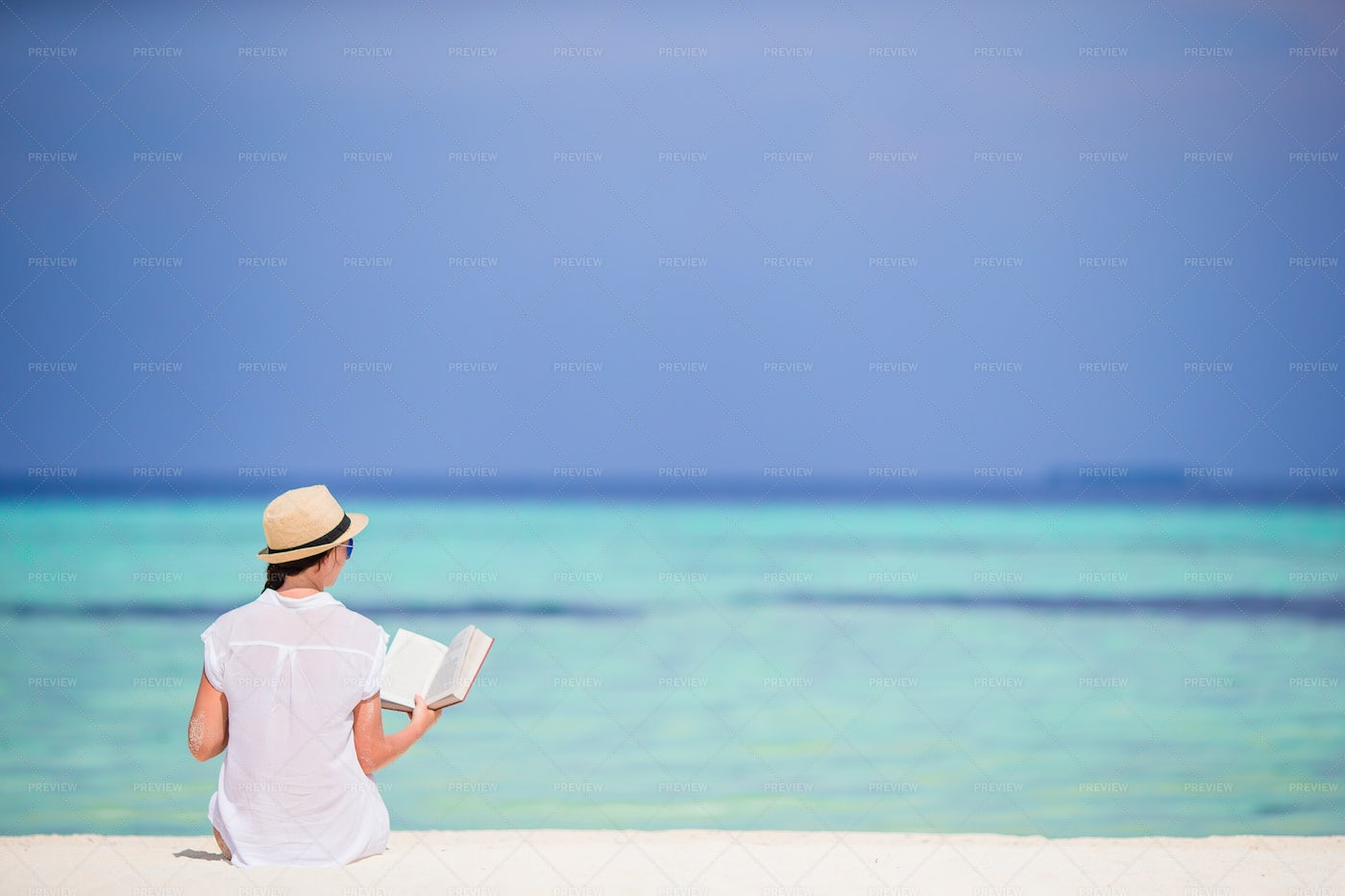 Relaxing And Reading Beachfront: Stock Photos