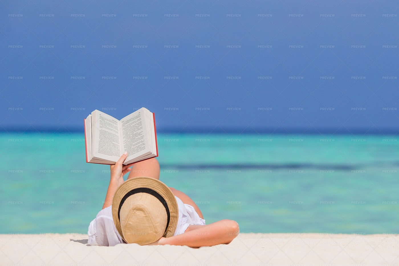 Laying And Reading Beachfront: Stock Photos