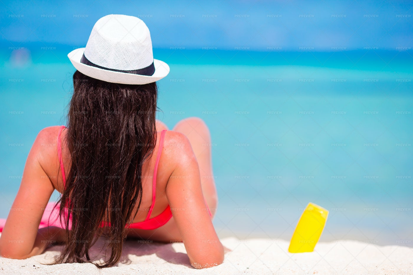 Sunscreen In The Sand: Stock Photos