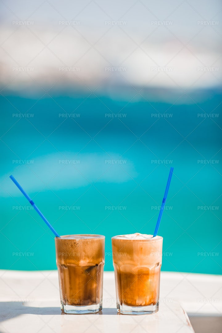 Frothy Frappes By The Water: Stock Photos