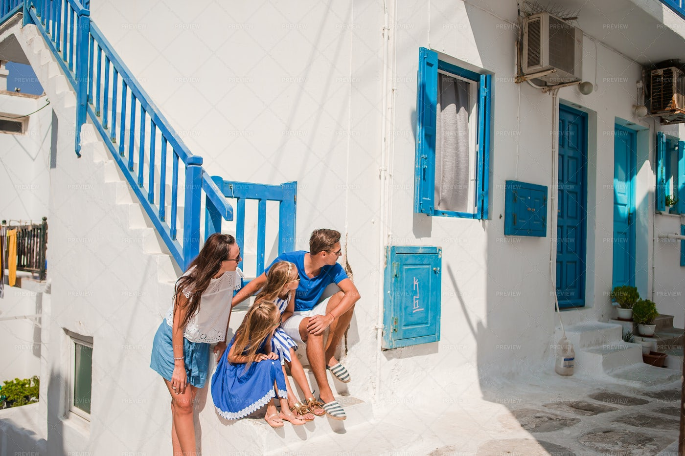 Family On A Stoop In Greece: Stock Photos