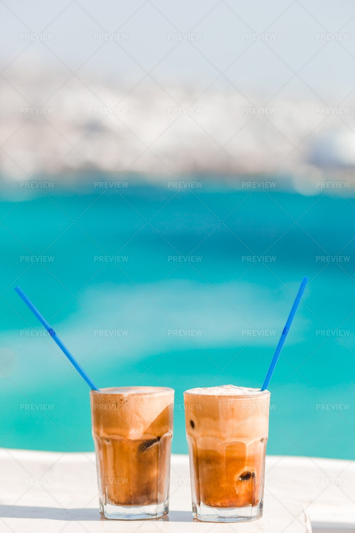 Ice Coffees In Front On The Beach: Stock Photos