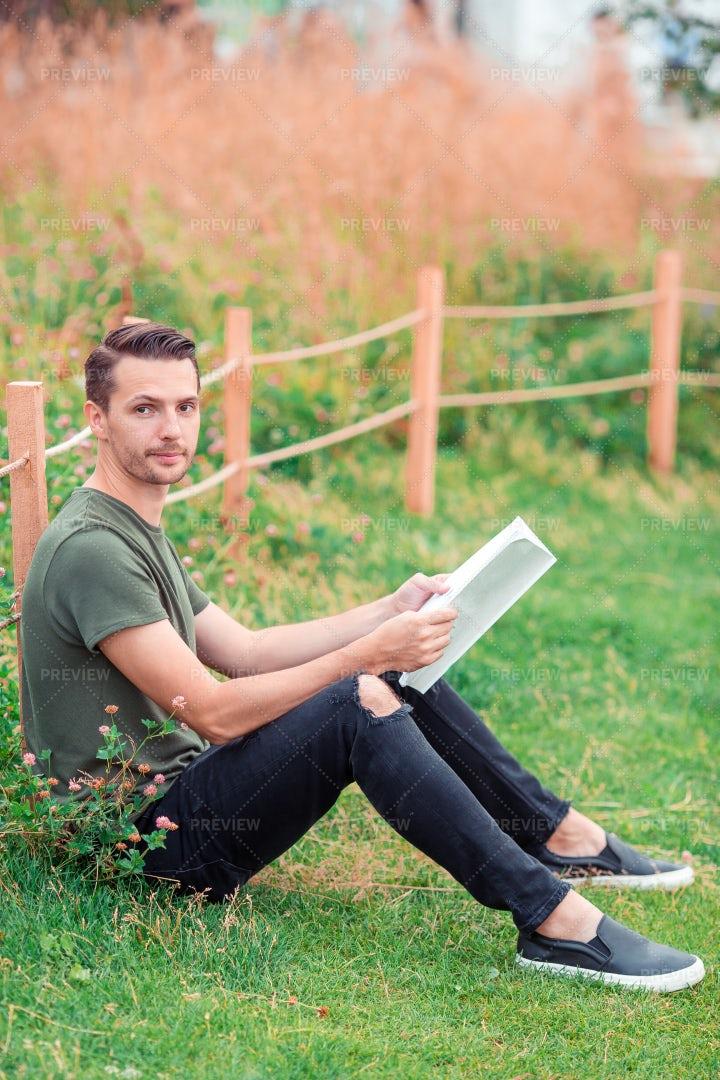 Reading A Book In A Park: Stock Photos