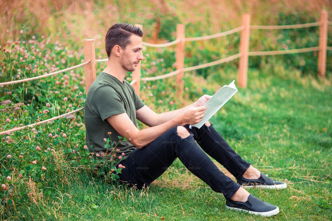 Man Reading A Book In A Park: Stock Photos
