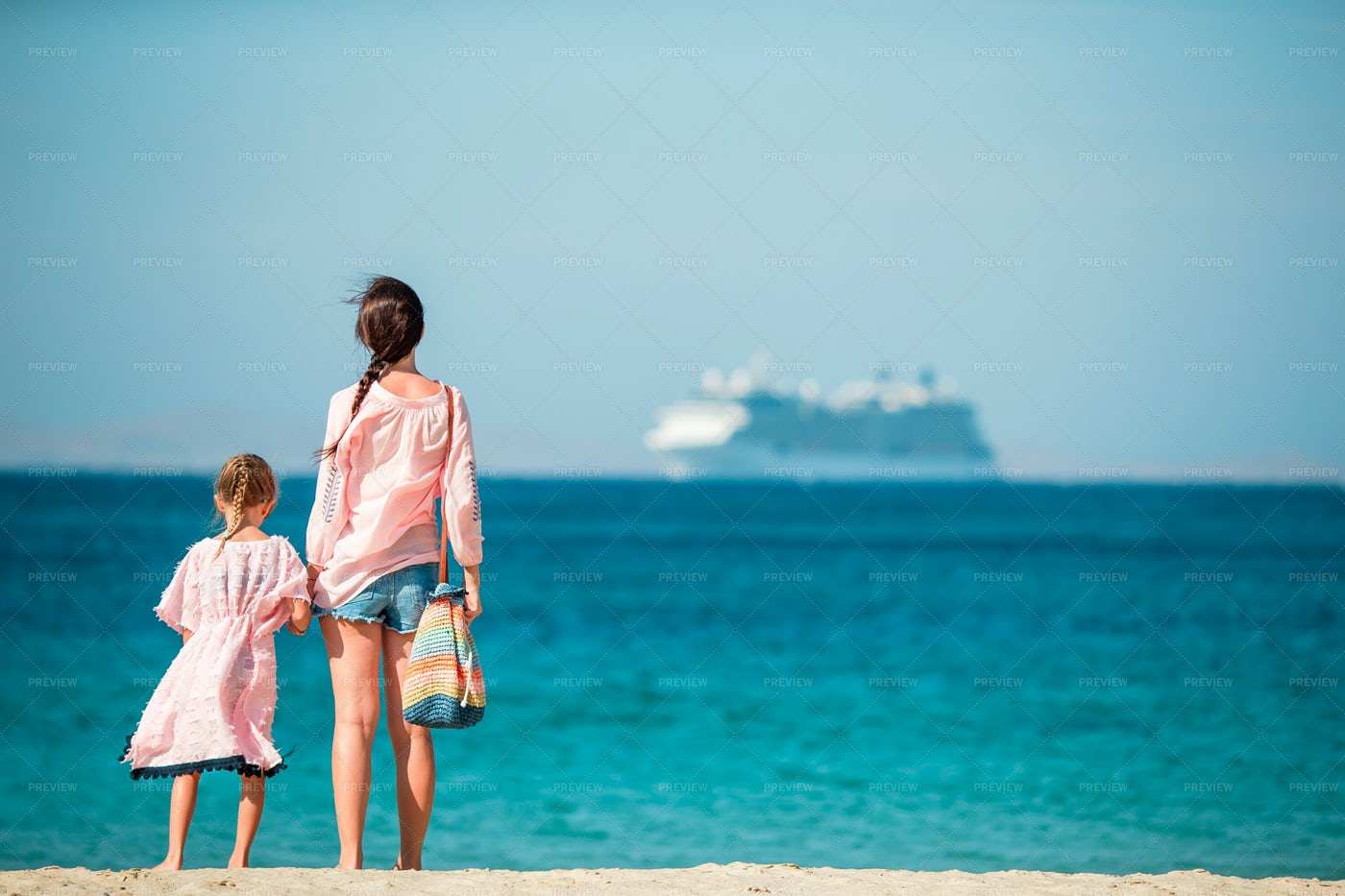 Mom And Daughter Contemplating The Sea: Stock Photos