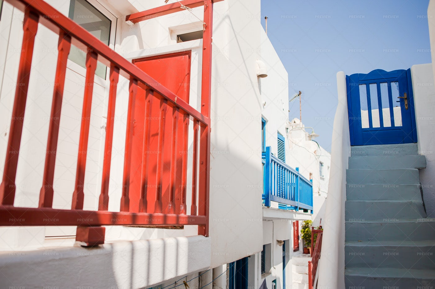 Blue And Red Balconies In Greece: Stock Photos