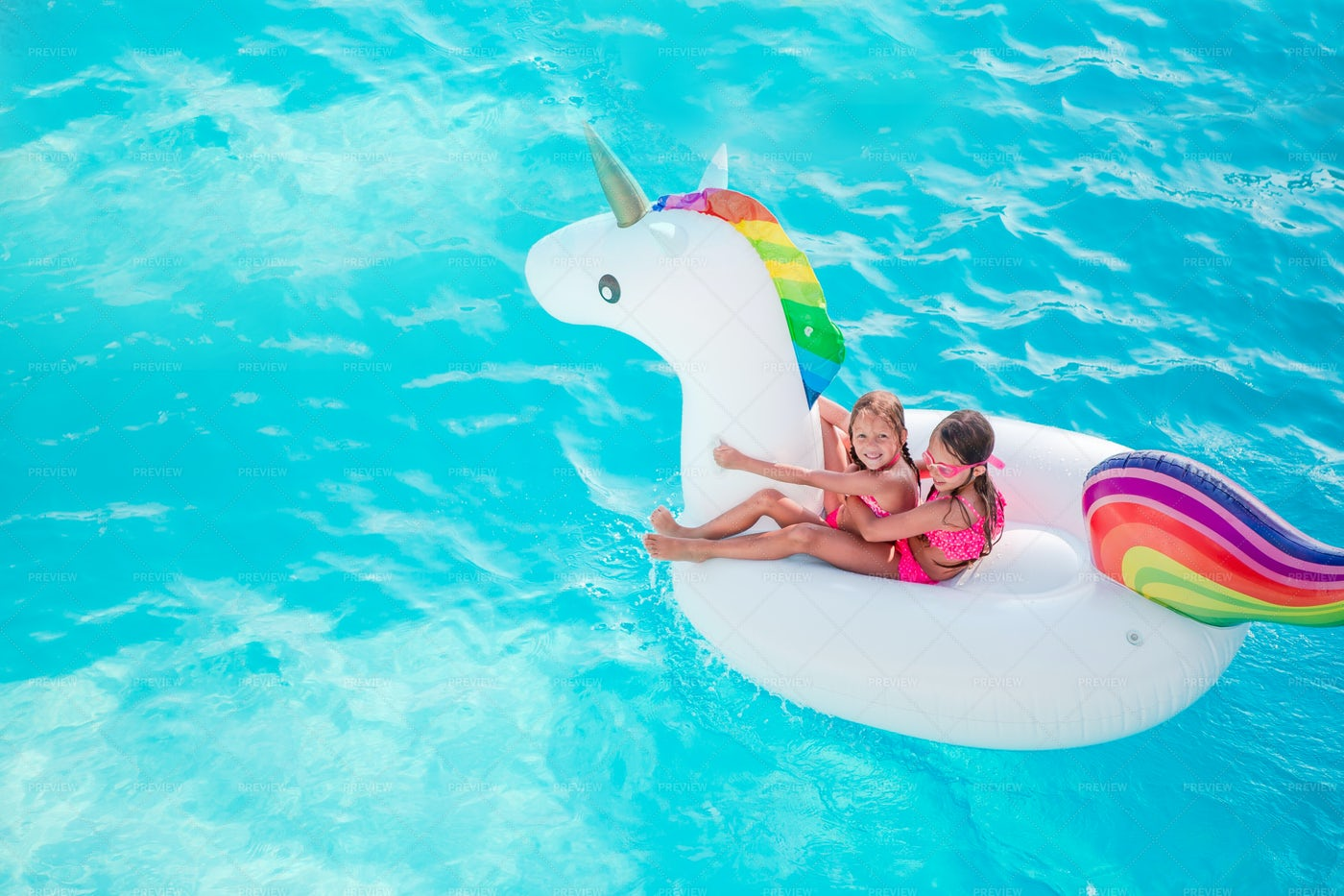 Kids On Unicorn Pool Float: Stock Photos