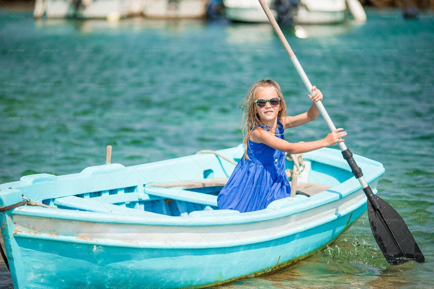 Girl In Rowboat: Stock Photos