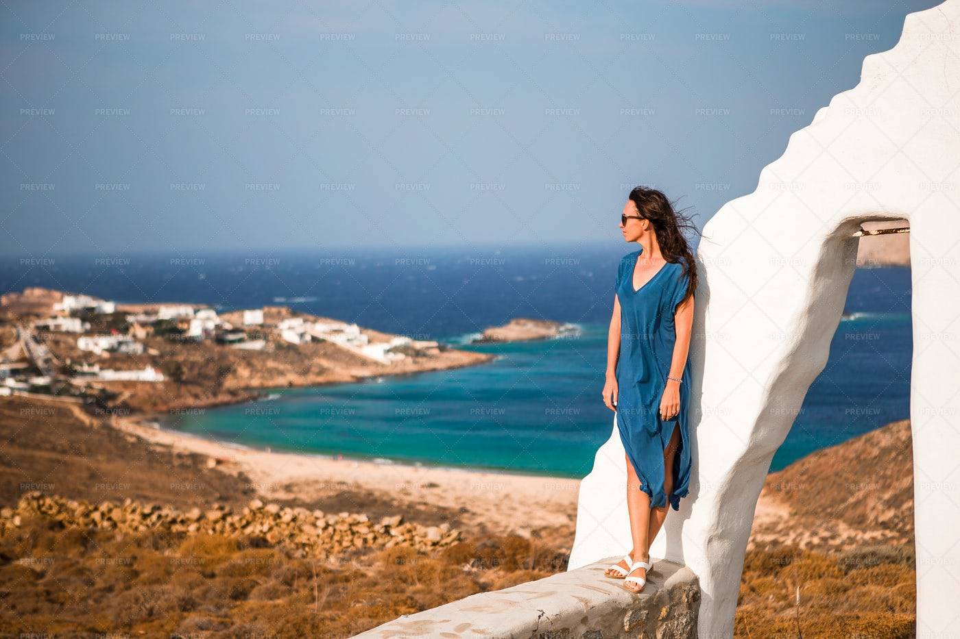 Woman Stands On Wall In Greece: Stock Photos