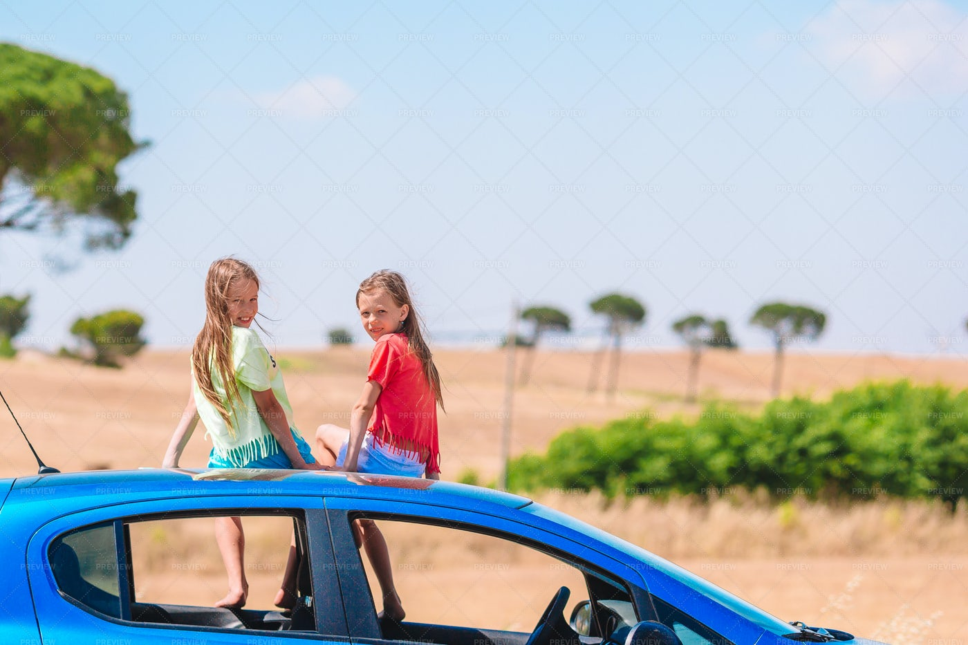Little Girls On The Car Roof: Stock Photos