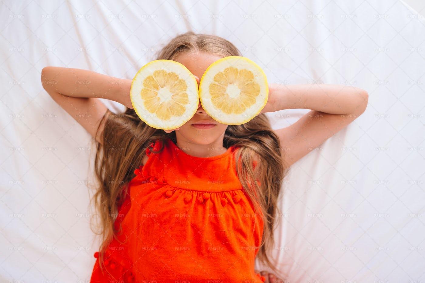 Girl With Lemon Halves: Stock Photos