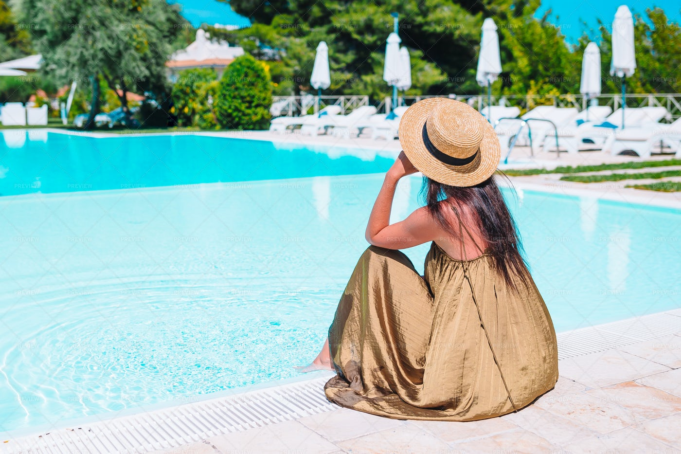 Young Woman Relaxing By The Pool: Stock Photos