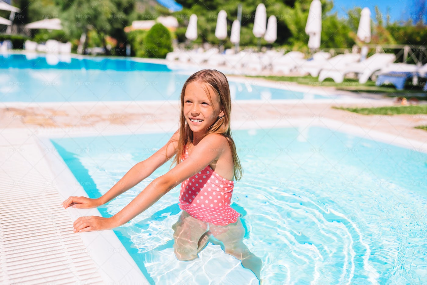 Girl In A Kid´s Swimming Pool: Stock Photos