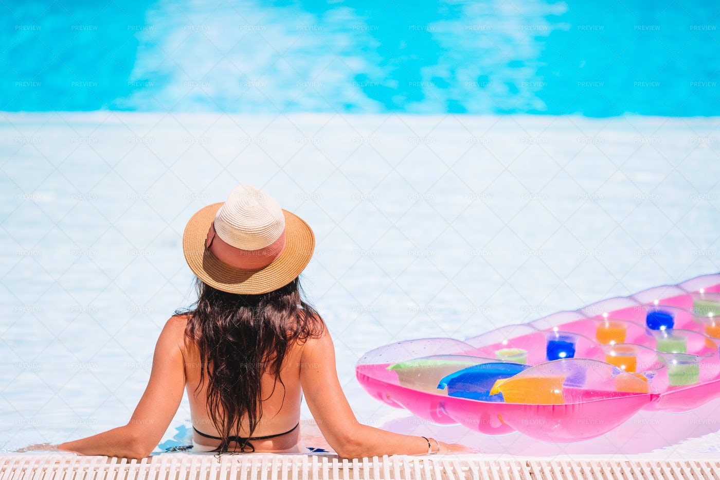 Woman Relaxing Near Pool Float: Stock Photos