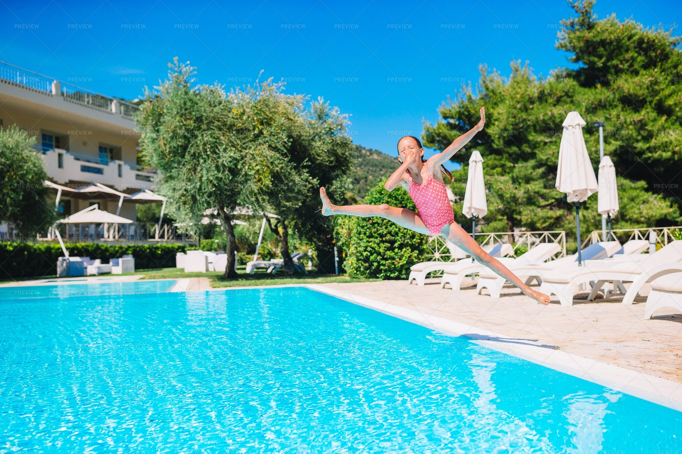 Jumping Into The Pool: Stock Photos