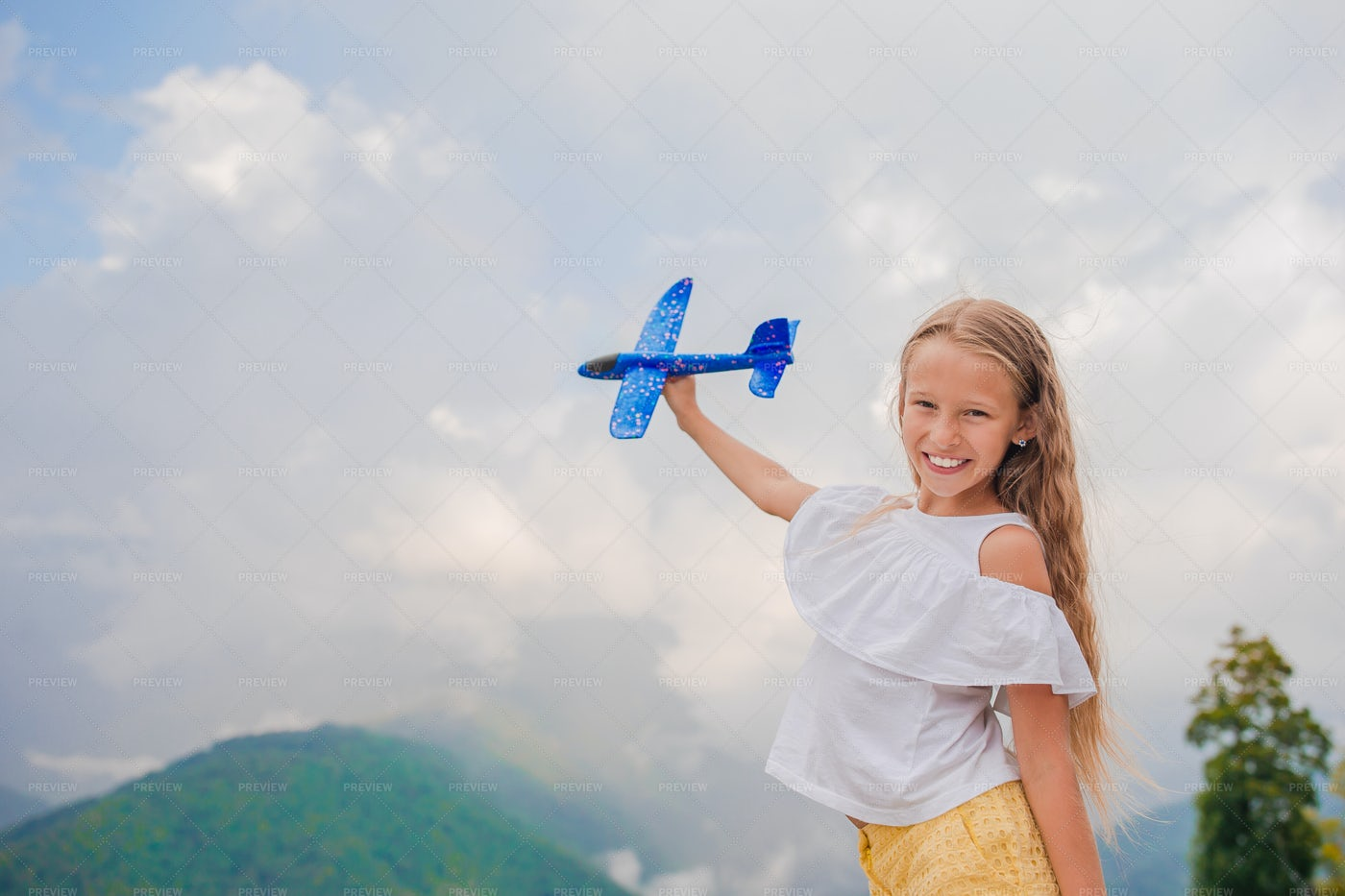 Girl With A Toy Plane: Stock Photos