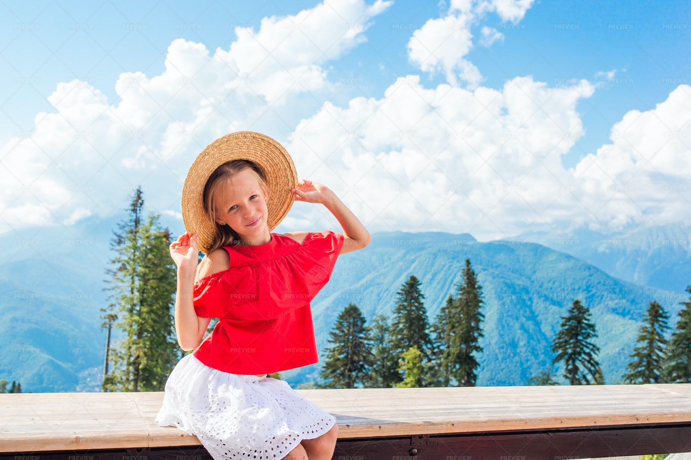 Happy Little Girl In The Mountains: Stock Photos