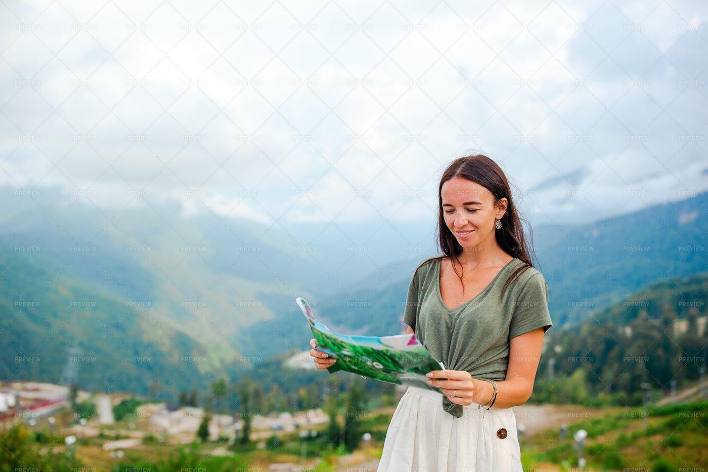 Woman Reading A Map: Stock Photos