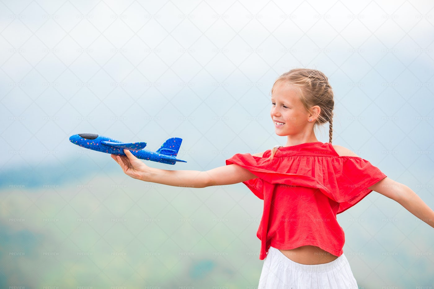 Girl With Toy Plane: Stock Photos