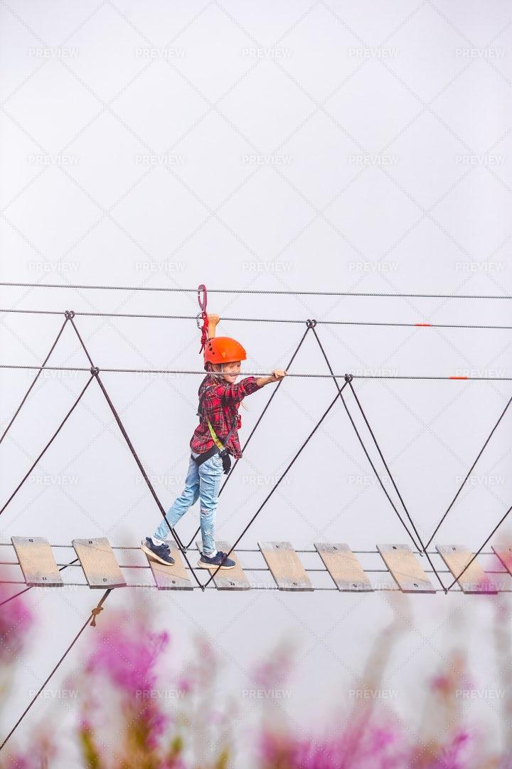 Child On The Rope Bridge: Stock Photos