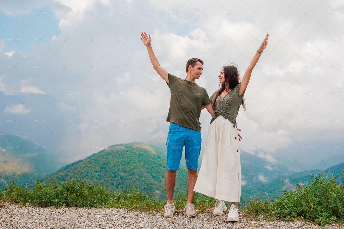 Couple Atop The Mountains: Stock Photos
