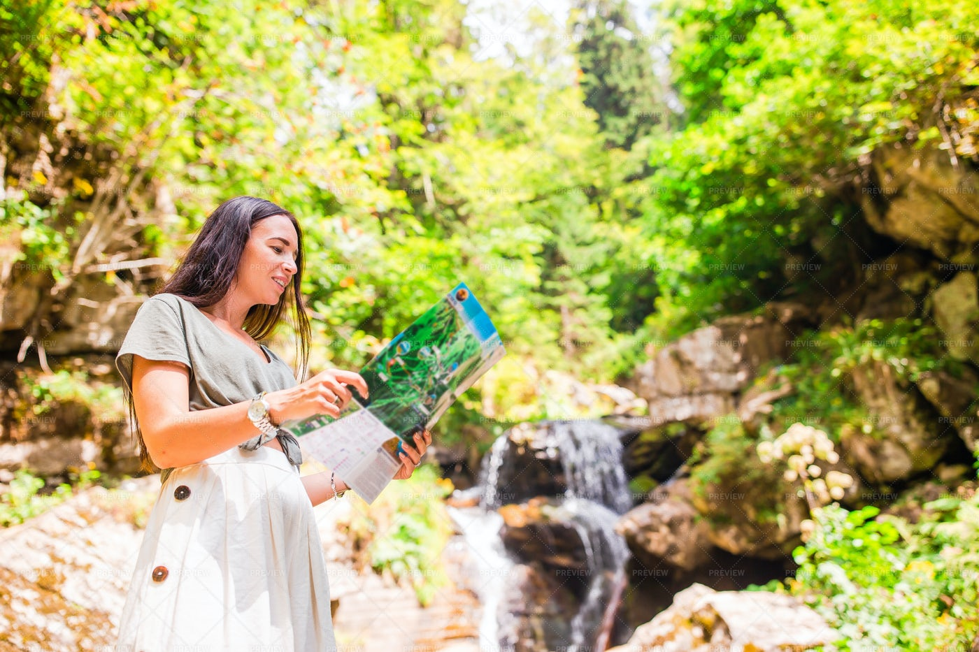 Woman Check Hiking Map: Stock Photos