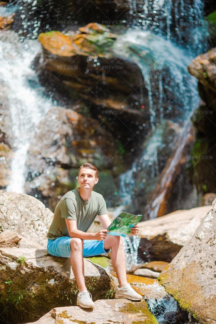 Man Enjoys The Waterfall: Stock Photos