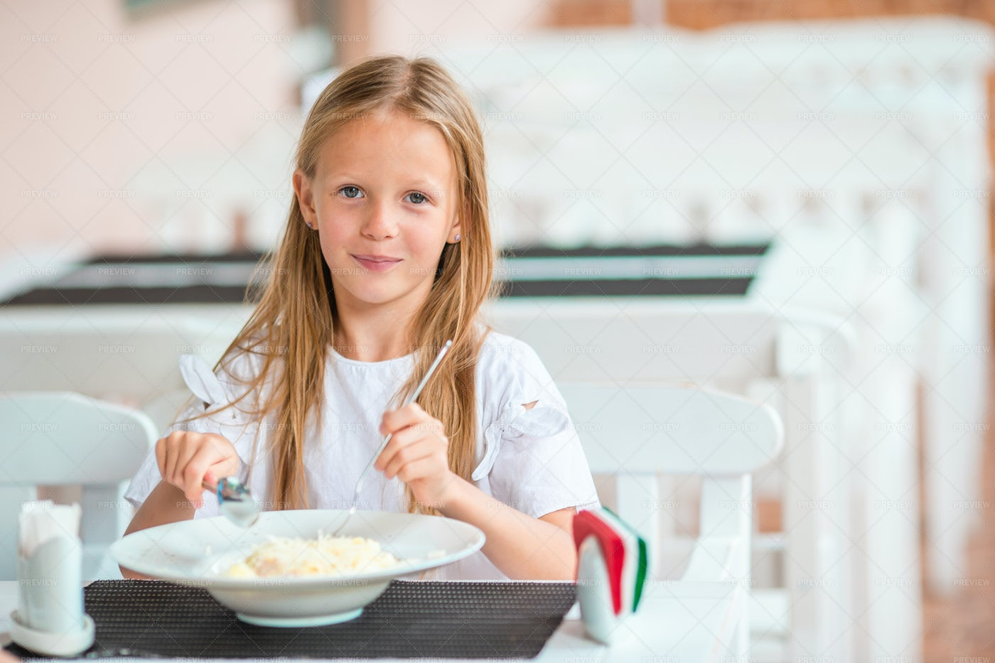 Young Girl Eating Breakfast: Stock Photos