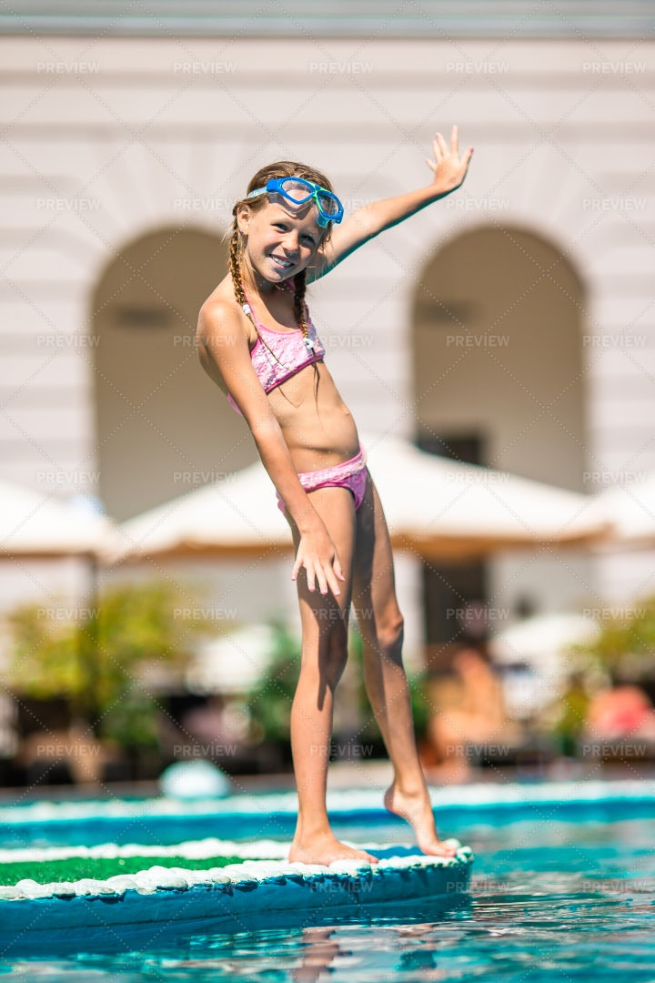 Girl Outside A Swimming Pool: Stock Photos