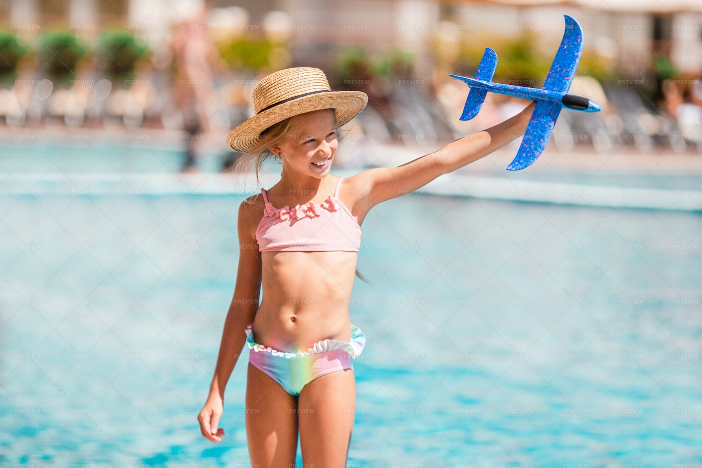 Playing Beside The Pool: Stock Photos