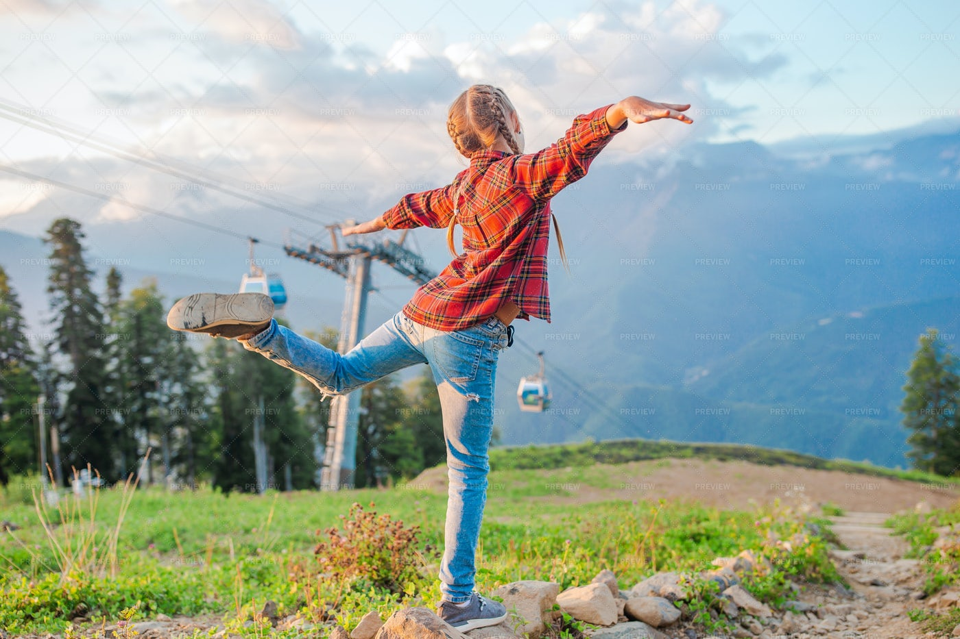 Happy Little Girl In Mountains: Stock Photos