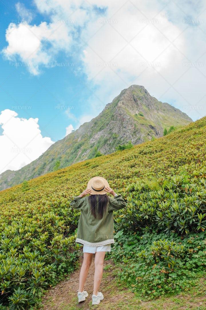 Woman Amazed By The Mountain: Stock Photos