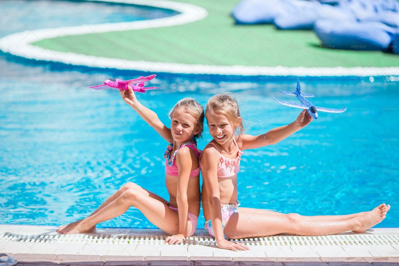 Playing With Airplane Toy In Pool: Stock Photos