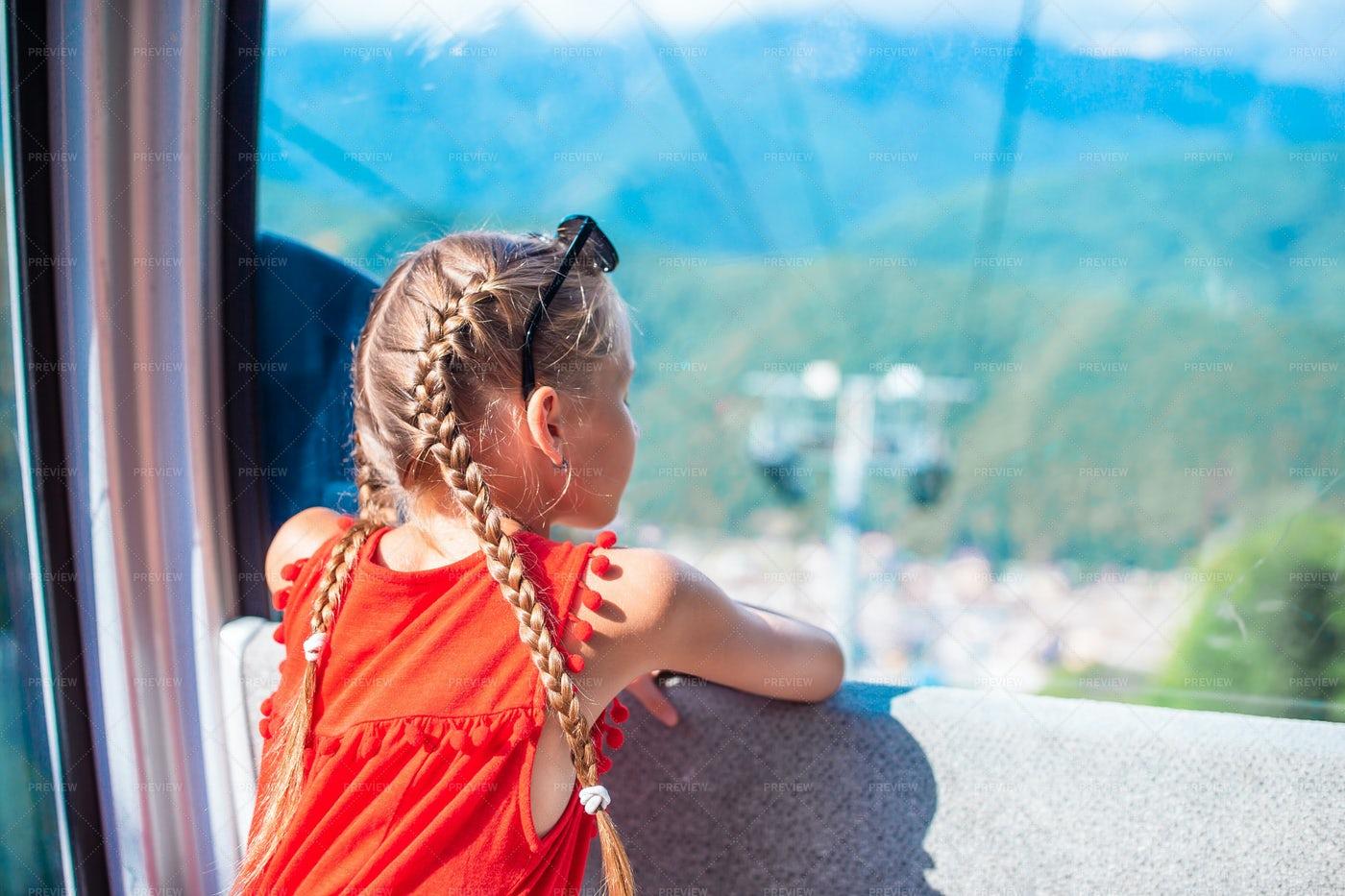 Little Girl On A Cable Car: Stock Photos