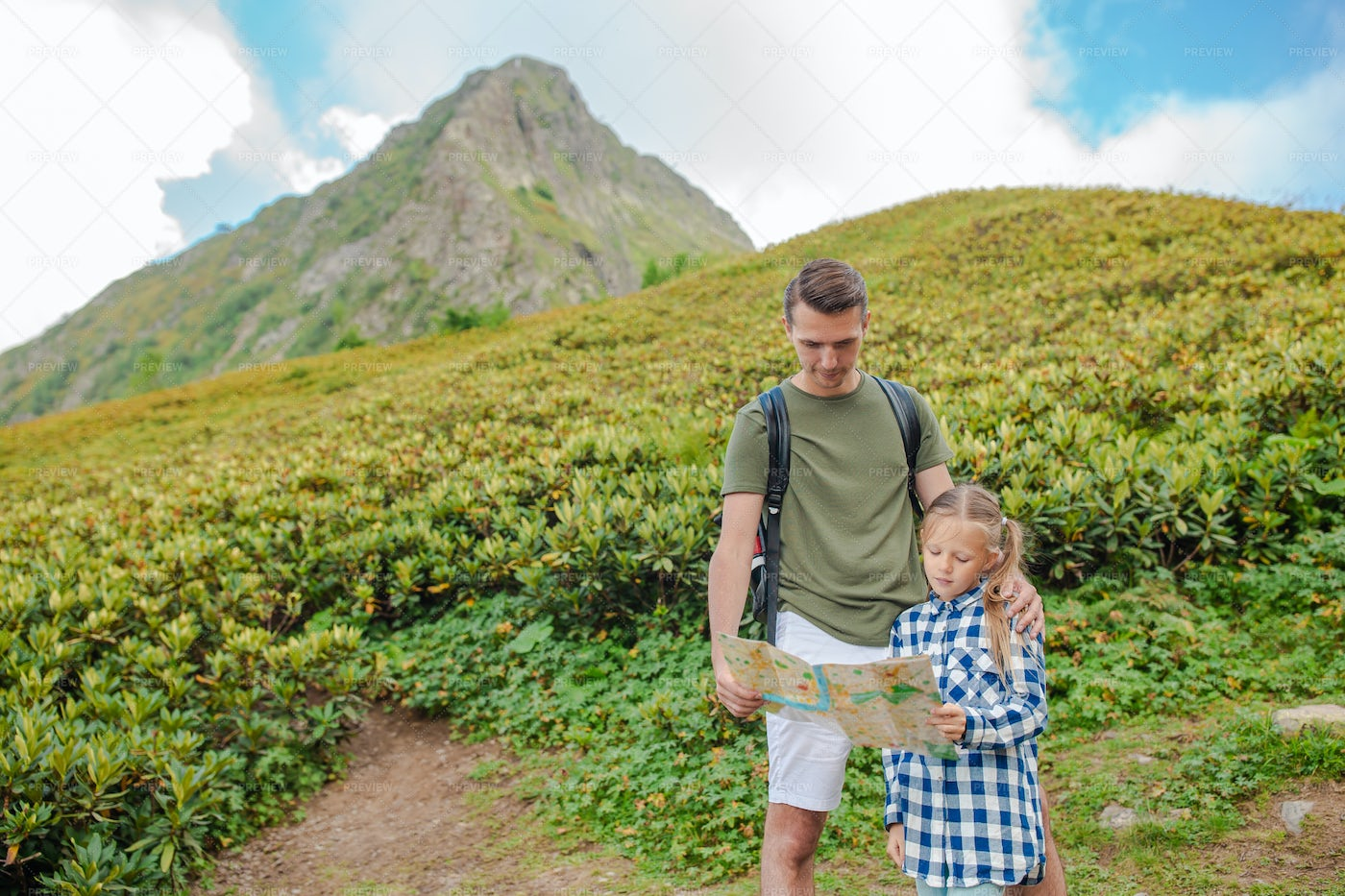 Dad And Little Girl In The Mountains: Stock Photos