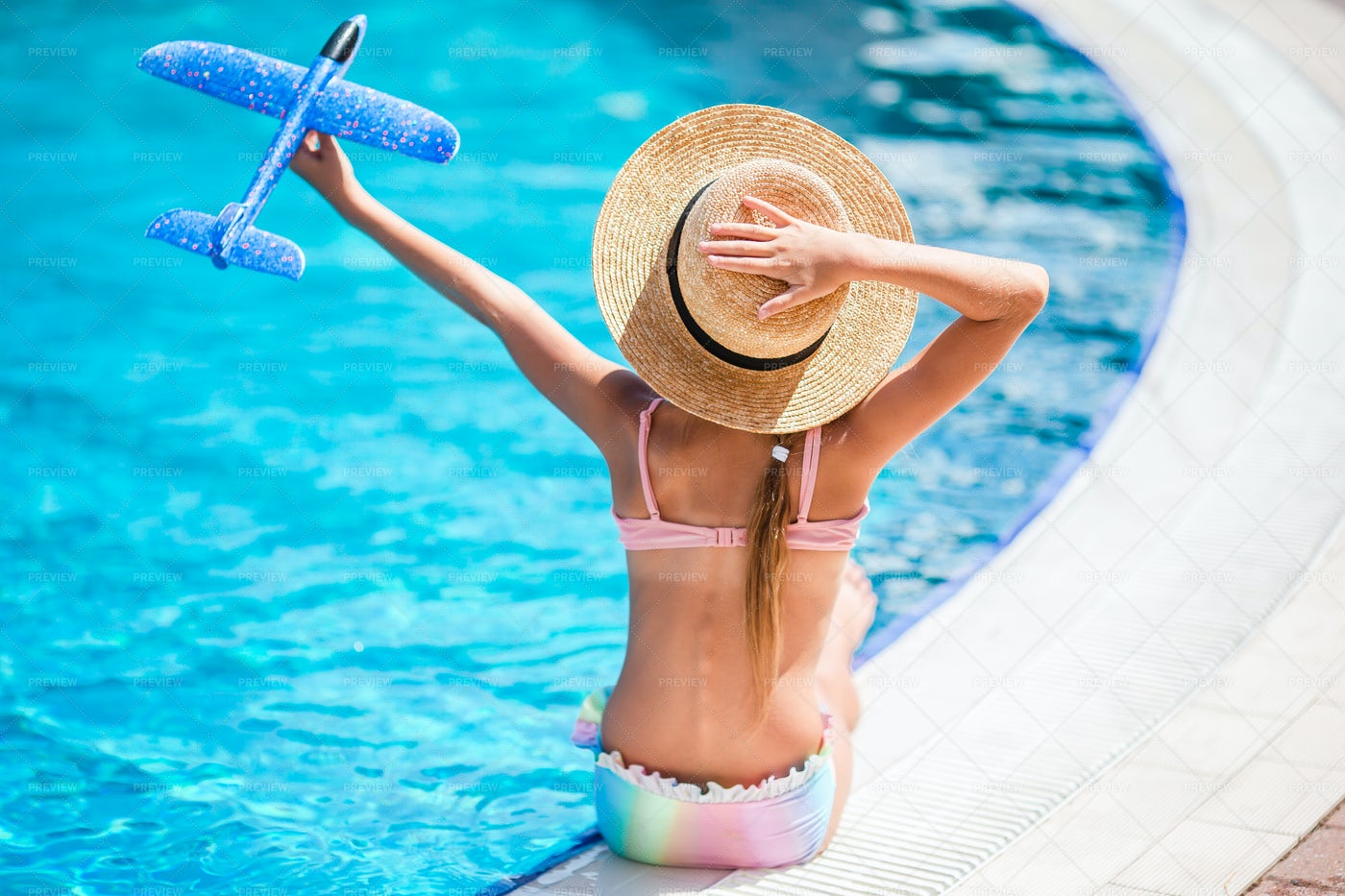 Playing Near The Pool: Stock Photos