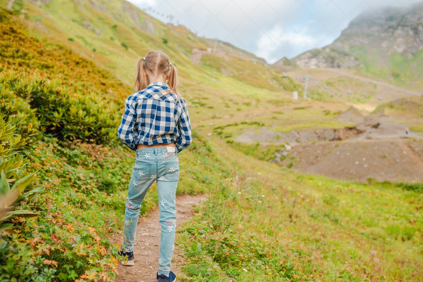 Little Girl Walking In The Mountains: Stock Photos