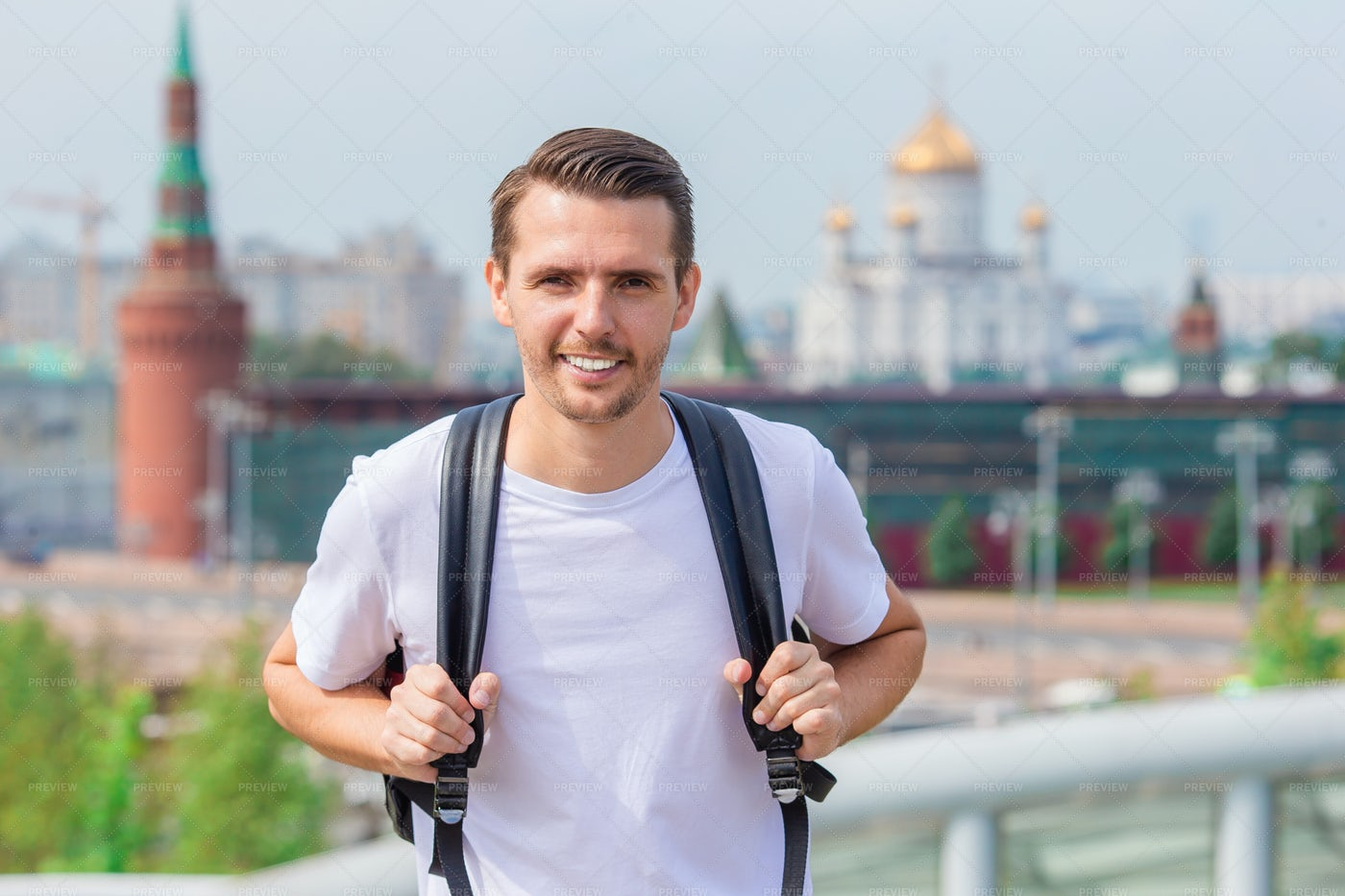 Tourist Guy Smiling In A Big City: Stock Photos