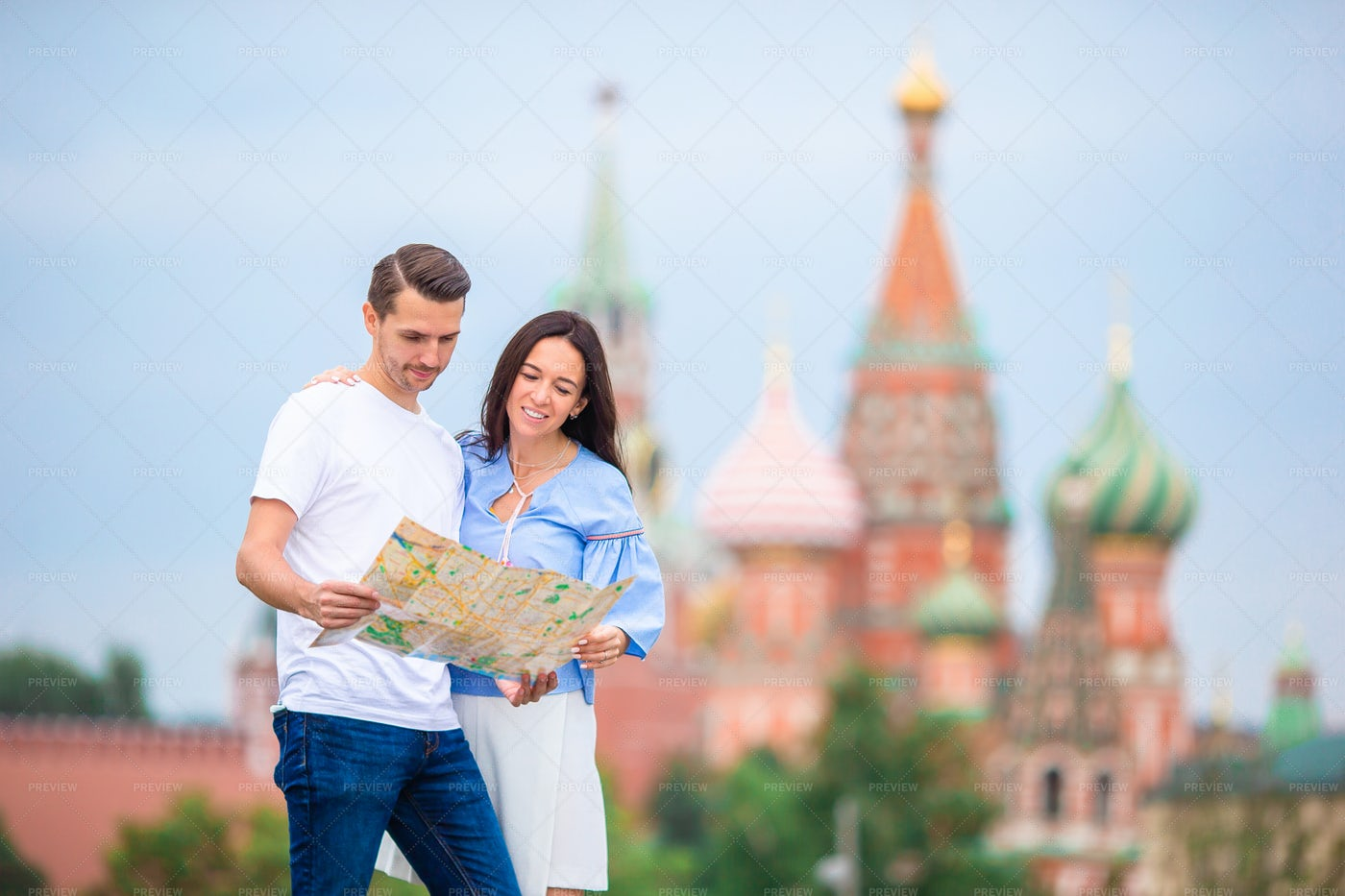 Couple With Map In Moscow: Stock Photos