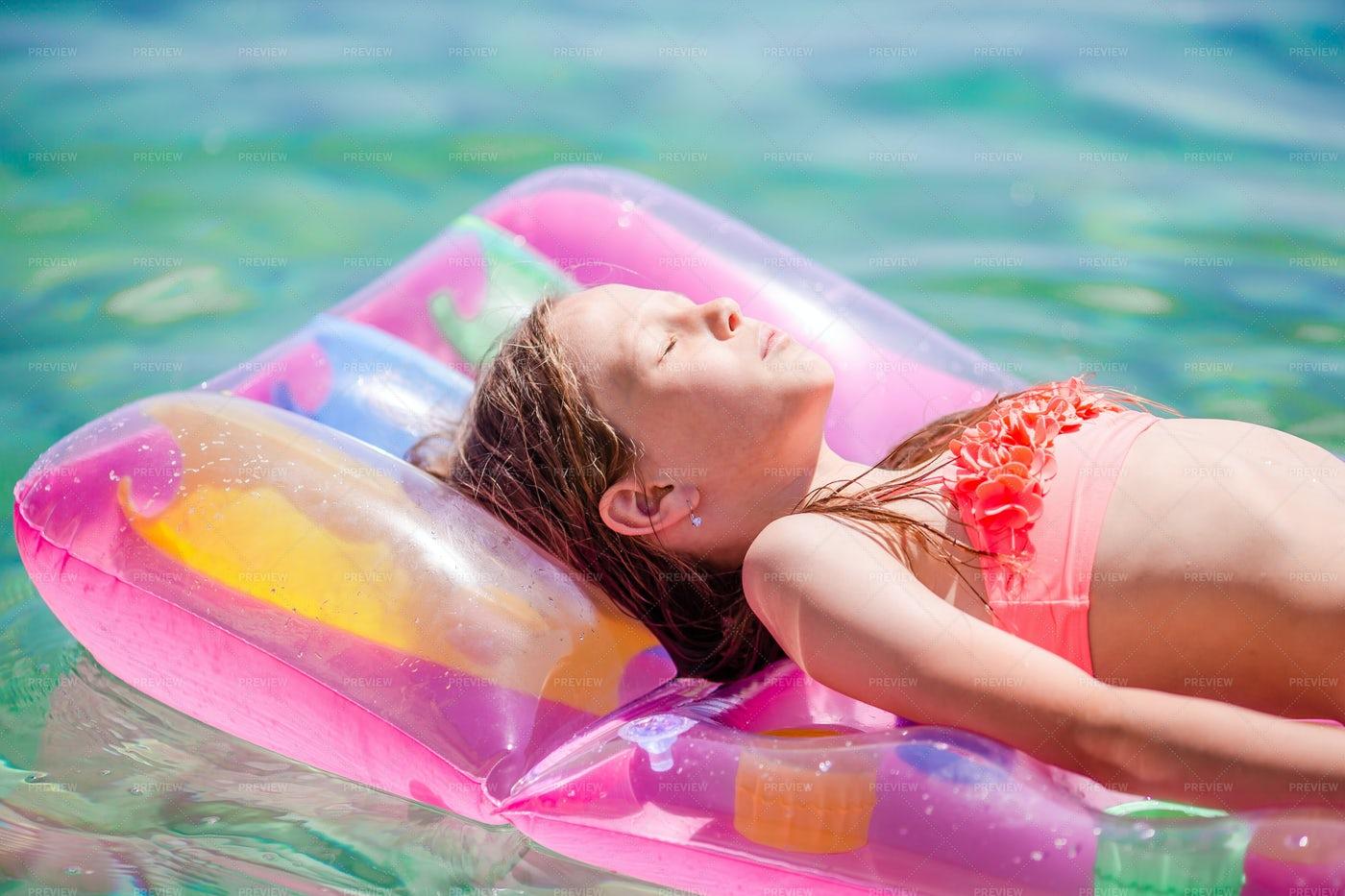 Sunbathing On Inflatable Air Mattress: Stock Photos