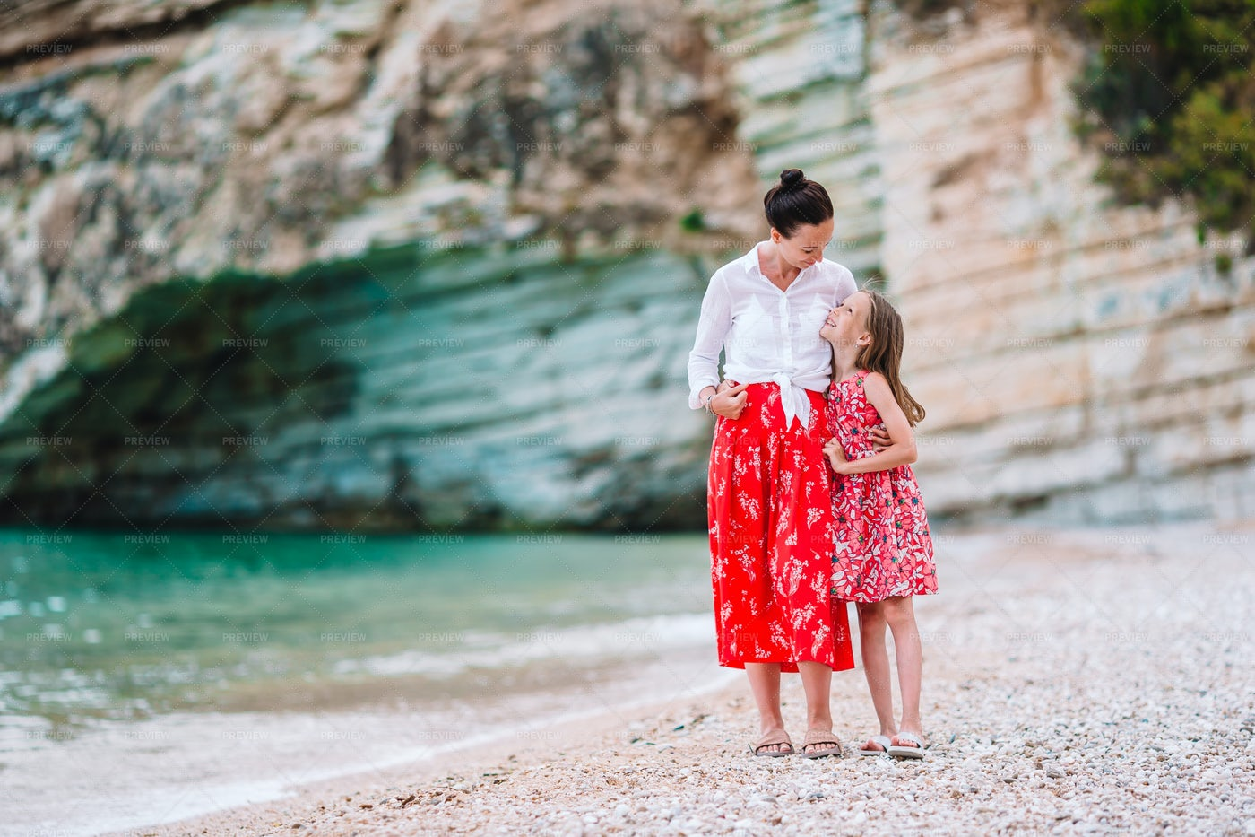Mother And Little Daughter At The Beach: Stock Photos