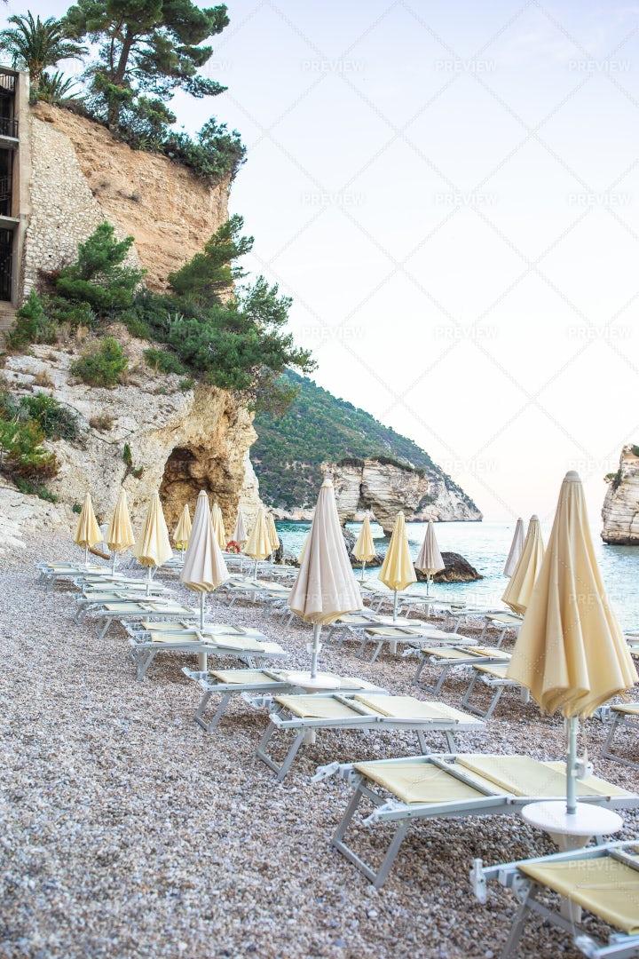 Sunbeds And Umbrellas At Coastline: Stock Photos