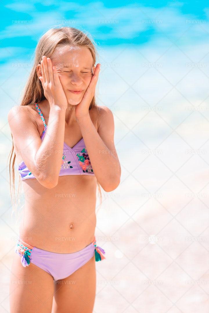 Sun Cream On The Face: Stock Photos