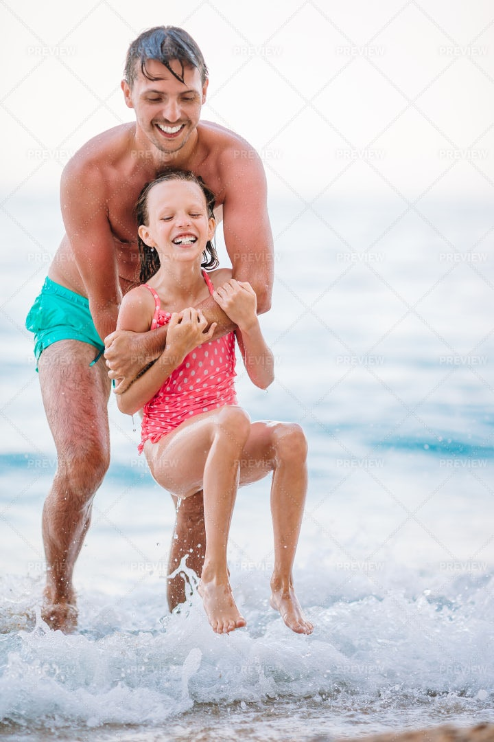 Playing In The Waves: Stock Photos