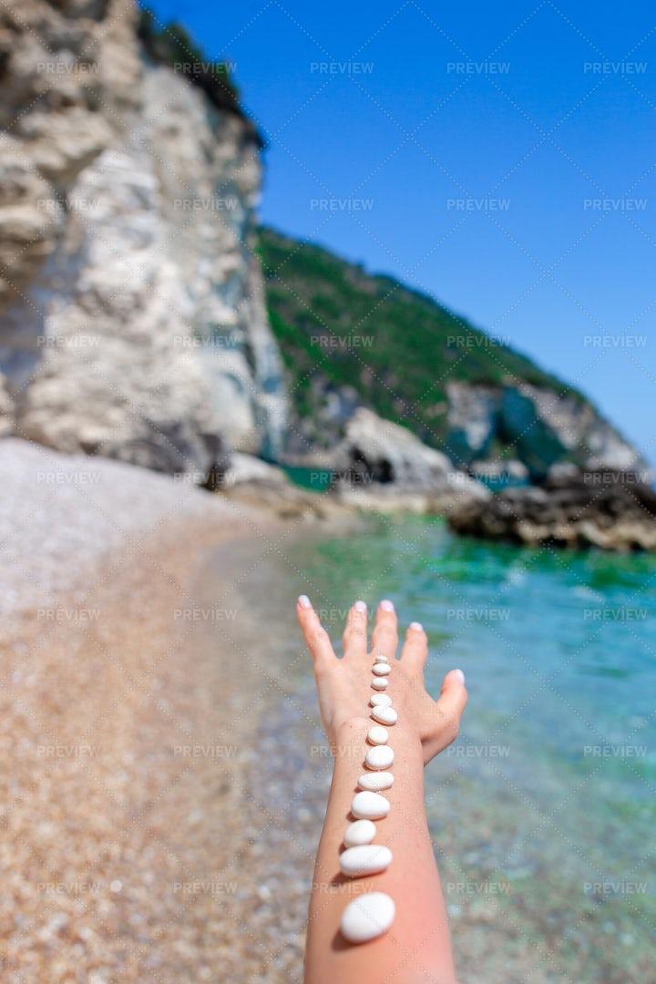 Beach Stones On The Arm: Stock Photos