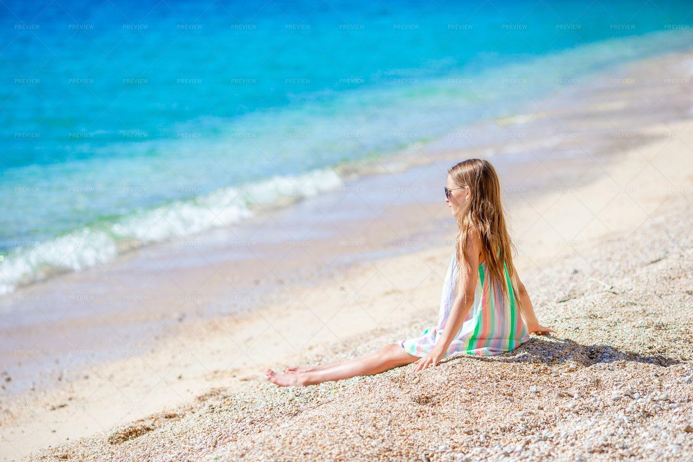 Little Girl Observing The Beach: Stock Photos