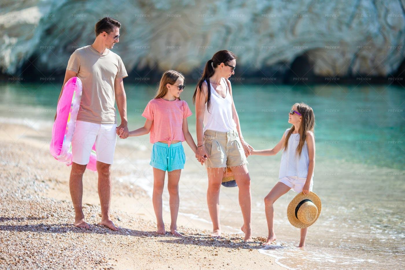 Family Walking On The Beach: Stock Photos