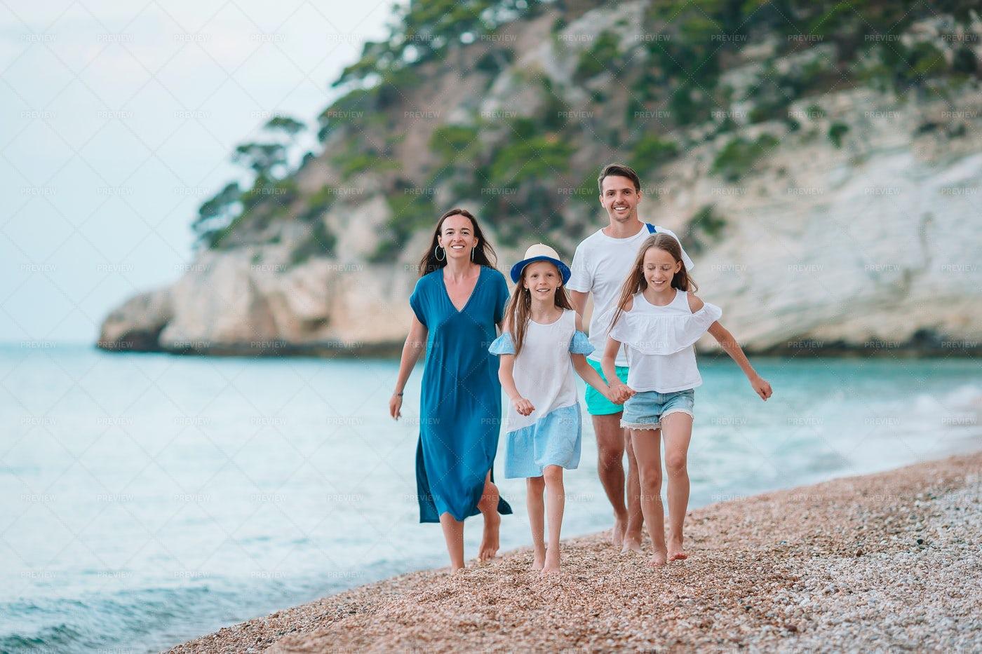 Family On Beach Pebbles: Stock Photos